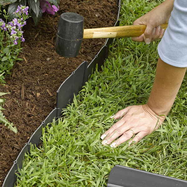 Pound in edging by Professional landscaping services